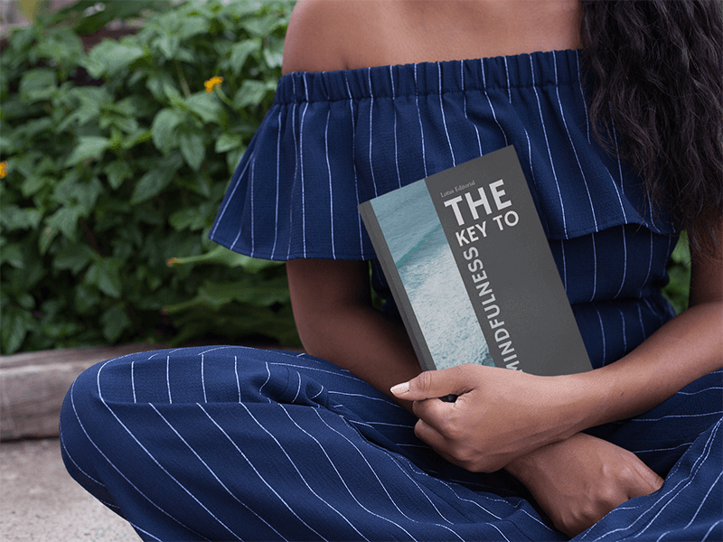 Cropped Face Girl Holding A Book Mockup Outdoors