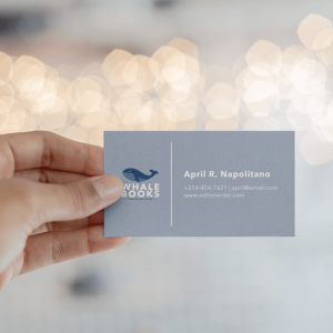 Mockup Of A Business Card Being Held Against Blurred Lights