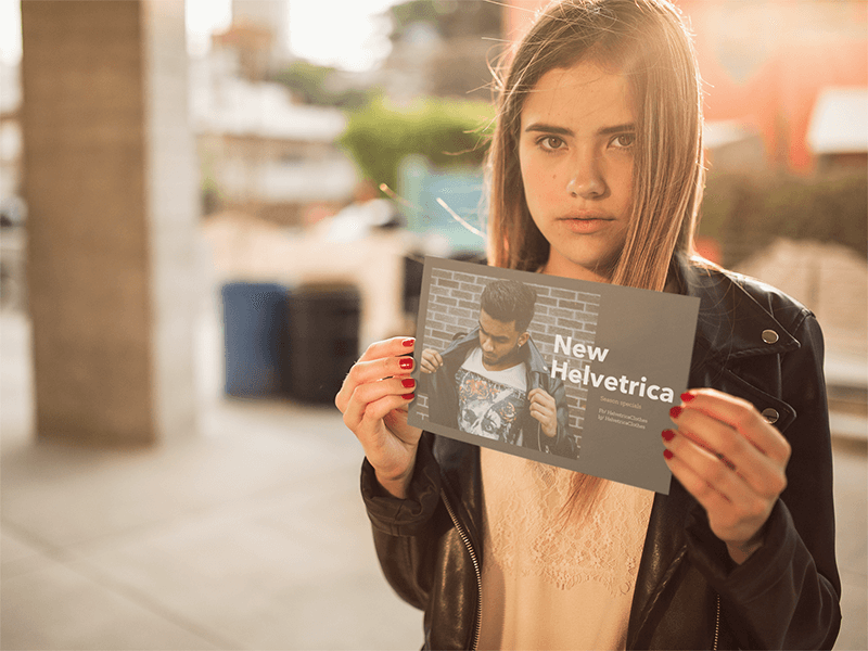 Girl Holding A Horizontal Flyer Mockup With An Apparel Flyer Design