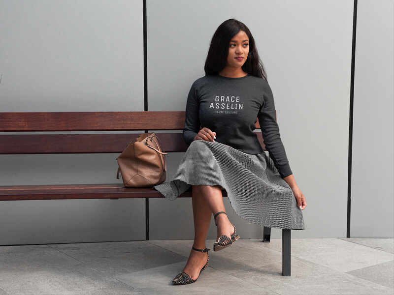 Pretty Girl Wearing A Crew Neck Sweatshirt Template While Sitting On A Bench