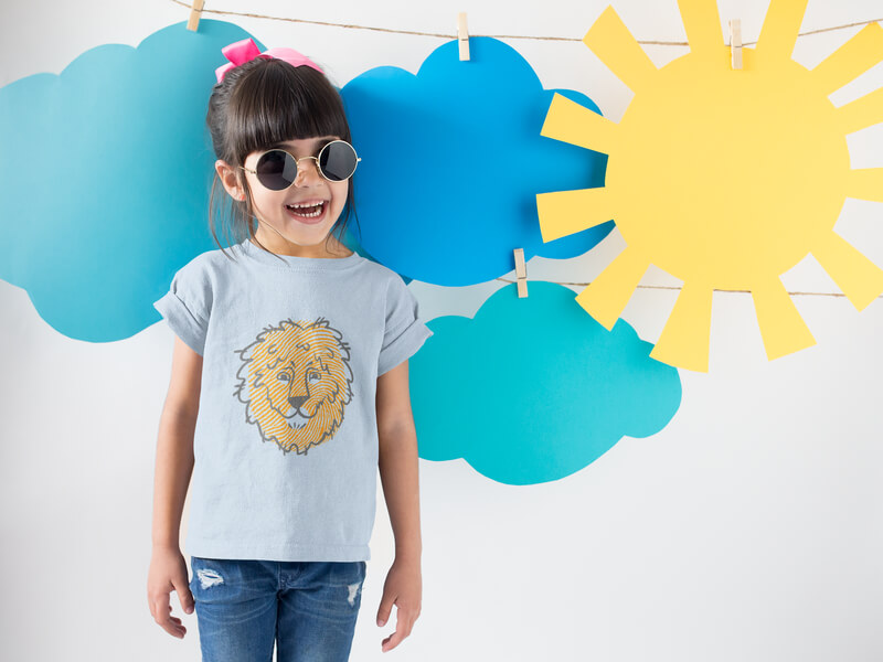 Smiling Girl Wearing A Round Neck Tshirt Template Near Cardboard Sun And Clouds