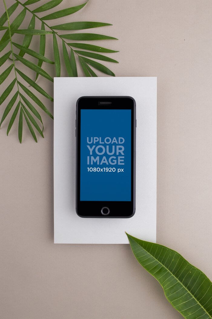 Space Gray Iphone Mockup Surrounded By Green Leaves