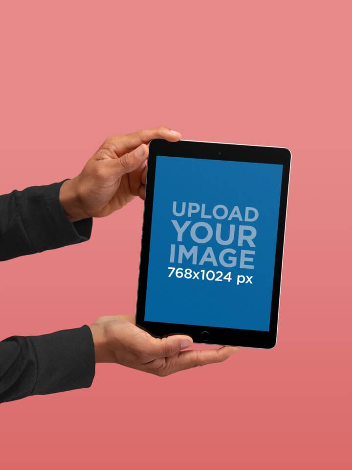Ipad Mockup Being Held Against A Solid Color Background 22645