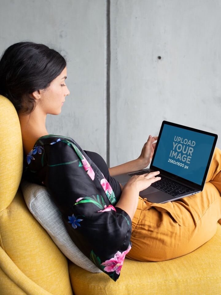 Woman On A Yellow Sofa With A Macbook Mockup