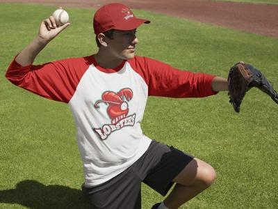 Teen Boy Playinig as Catcher Outdoors