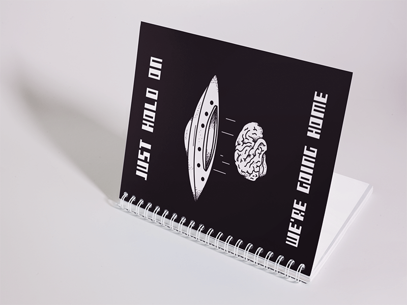 Big Spiral Notebook Template Lying On A White Surface While Opening