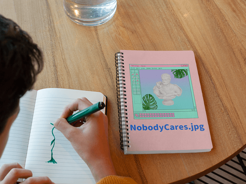 Notebook Mockup Featuring A Boy Drawing