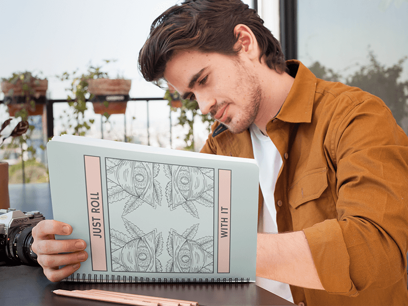 Notebook Mockup Featuring A Man Writing