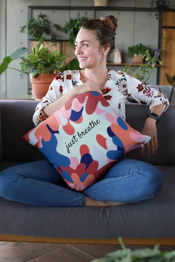 Mockup Of A Smiling Woman Holding A Pillow At A Lounge