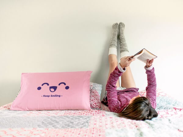 Young Girl Reading Upside Down Near To A Pillow Mockup A14939 (1)