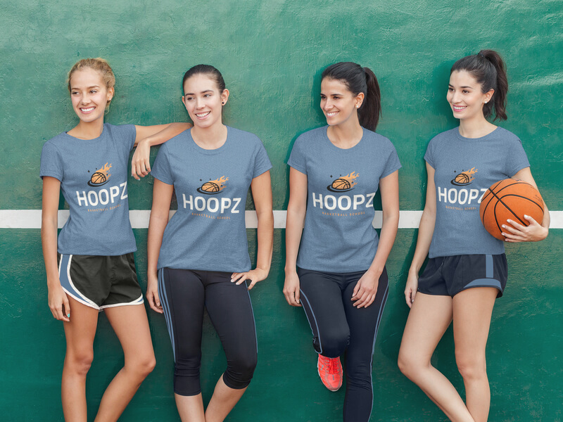 Group Of Four Girls Wearing Different Tees Mockup While On A Basketball Court Wearing Basketball Tees